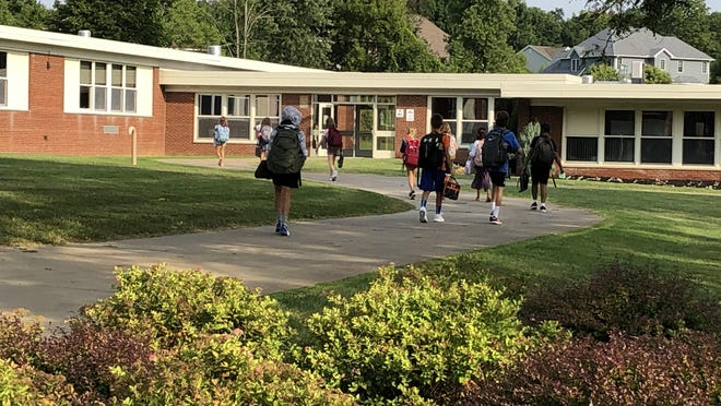 Students walk into Hart's Hill Elementary School in the Whitesboro Central School District on the first day of school on Tuesday, Sept. 8, 2020. The district will switch to fully remote learning from Nov. 30 to Dec. 22, during which time 103 non-instructional staff members will be furloughed.