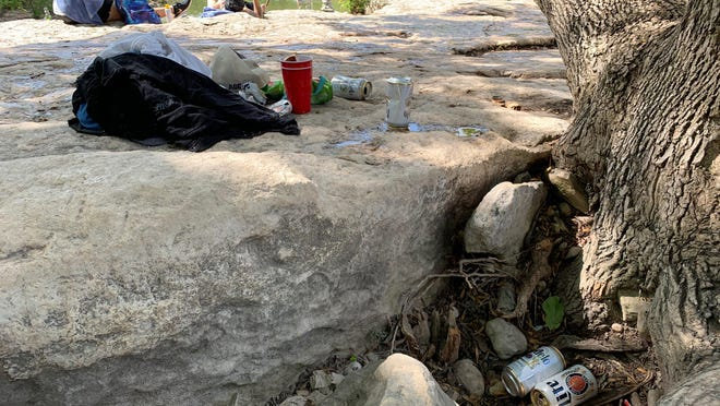 Neighbors say visitors often leave trash, including food wrappers and beers cans, behind.