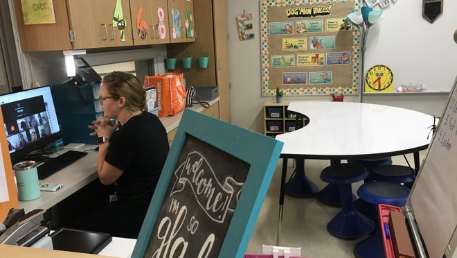 Third grade teacher Katie Eskridge walked students through digital classroom etiquette Wednesday morning while learning from home over the next three weeks.