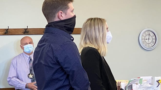 Carroll County Deputy Jacob Baker stands with his attorney at his arraignment in August in Carroll County Common Pleas Court. Baker is charged with voluntary manslaughter, the felony stemming from a traffic stop in November 2019. A hearing in Baker's case set for Friday was canceled because the special prosecutor is recovering from COVID-19.