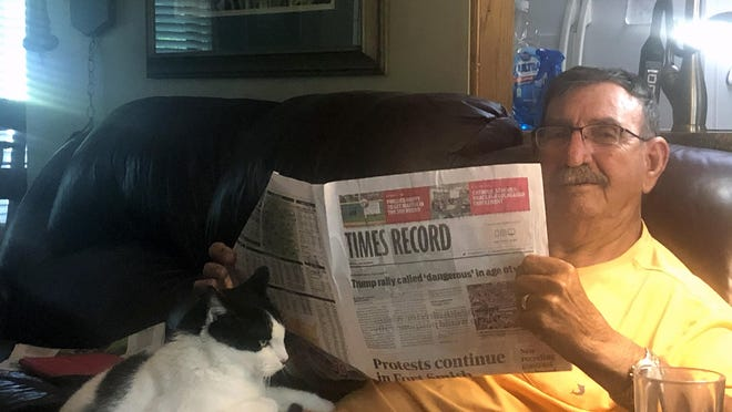 R.E. Boyett with Patches reading the Times Record recently at their home in Fort Smith. Boyett has been a subscriber to the Times Record newspaper for 46 years.