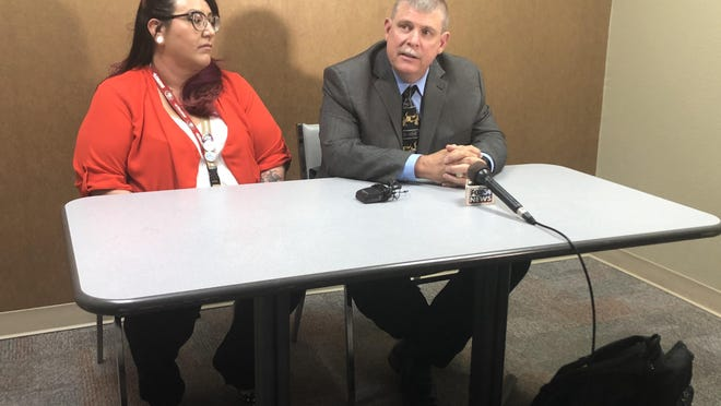 Dr. Charles Addington, right, and Bambi Trevino, left, answered questions from the media on Tuesday about Addington's appointment as Lubbock County Medical Examiner.
