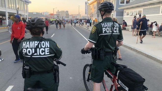 Hampton police officers Shannon Feeley and Justin Leduc patrol Ocean Boulevard on bike.
