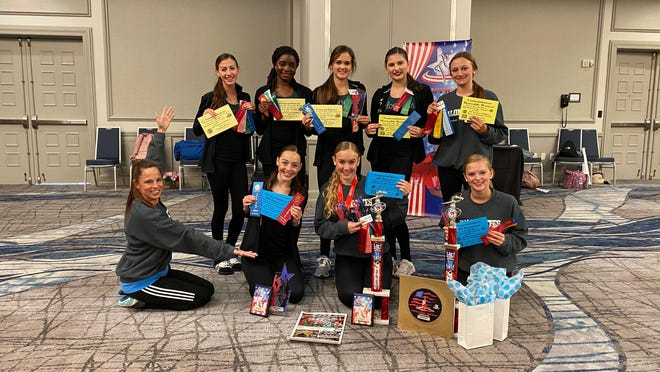 The officers of Prosper High School's Talonettes pose for a photo after participating June 29 through July 1 in a camp sponsored by American Dance and Drill at the Hilton Dallas/Rockwall Lakefront. Pictured in the front row  are, from left to right, Director Cali Hoffman, Julia Bisaillon, Zoë Dale and Ashley Ellis; back row, Lauryn Townsend, Destiny Olaleye, Hannah Gorgueiro, Mackenzie Albrecht and Madison Clark.