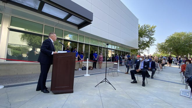 Colorado State University Pueblo President Timothy Mottet dedicates the school's newly remodeled Center for Integrated Health and Human Inquiry during a ribbon-cutting ceremony Thursday.