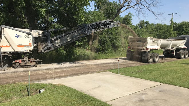 Crews remove the top layer of Lamar Avenue in May as a part of street repairs. For the upcoming budget, the city of Denison plans to invest $950,000 in street improvements and related expenses.