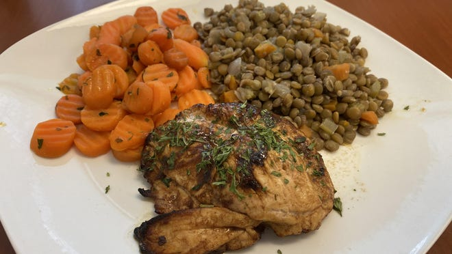 Meals on Wheels usually delivers more than 3,000 hot meals every day, including dishes like this five-spice chicken with ginger carrots, but during the coronavirus pandemic, the nonprofit has shifted to preparing meals that can be frozen and delivered every two weeks.