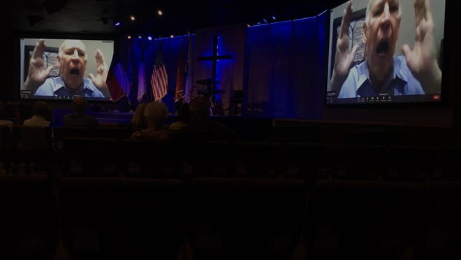 Rafael Cruz, speaking on video screens at Calvary Temple Church in Kerrville, introduced U.S. Rep. Chip Roy, a Republican from Hays County, at a campaign event Aug. 26.
