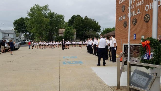 Members of the New Philadelphia High School Marching Quaker Band and VFW Post 1445 prepare for an observance of Patriot Day at the post on Friday.