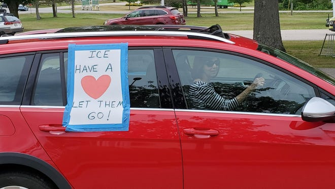 The Never Again Action, a car parade drove by the Strafford County jail Sunday in solidarity with immigrants detained there.