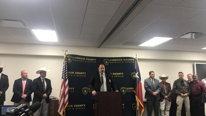 Lubbock County Sheriff Kelly Rowe, center, is joined by other law enforcement officials during a news conference to announce an arrest in the Cyntha Palacio homicide case Friday morning in Lubbock.