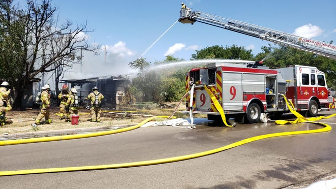 Lubbock Fire Rescue crews battled a two-alarm blaze that impacted two homes about 1:40 p.m. in the 3600 block of 32nd Street.