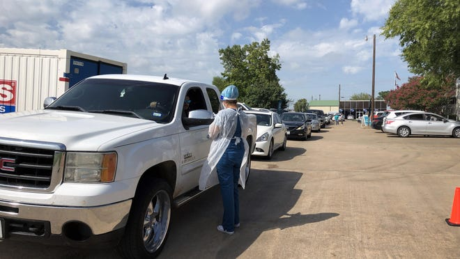 A line of cars waits at the Grayson County Health Department for the free COVID-19 testing that started there on Sept. 7. The drive through testing moved to the Midway Mall parking lot and continues to be open from 8 a.m. to 7 p.m.
