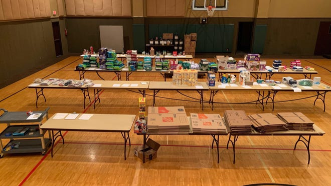 Supplies are arranged for pickup by volunteers at the First Baptist Church in Georgetown, which is serving as a warehouse for Williamson County donations during the pandemic.