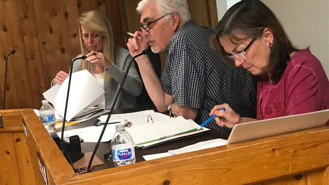 The West Lake Hills City Council reviewed a proposed budget Aug. 12 that includes minimal spending, a tax rate increase and road improvements.