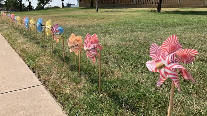 1,217 pinwheels are displayed around town as part of Pinwheels for Prevention, including outside of Covenant Children's Hospital. The number of pinwheels represent the number of confirmed child abuse cases in Lubbock County in 2019.