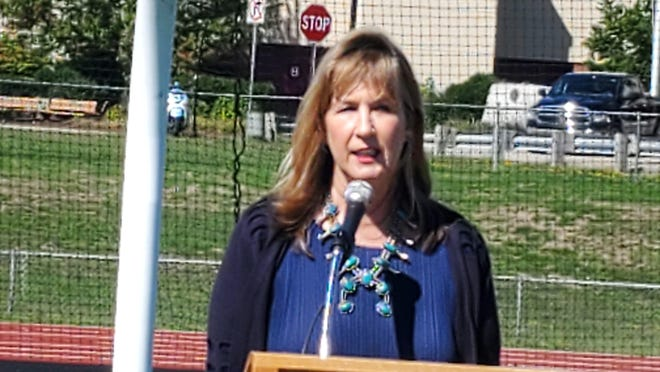 Claire McEachern, daughter of Paul McEachern, talks about growing up with her father at his memorial service, held Saturday on the athletic fields at Portsmouth High School.