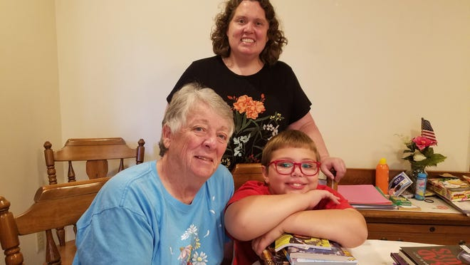 This image released by Renee Fry shows Fry, background center, with her mother Pat Fry, left, and son Liam Fry Hawker. Renee Fry, CEO and co-founder of an online estate planning business, moved in with her parents just outside State College, Pennsylvania, so Pat, a retired eighth-grade science teacher, could oversee Liam's online schooling.