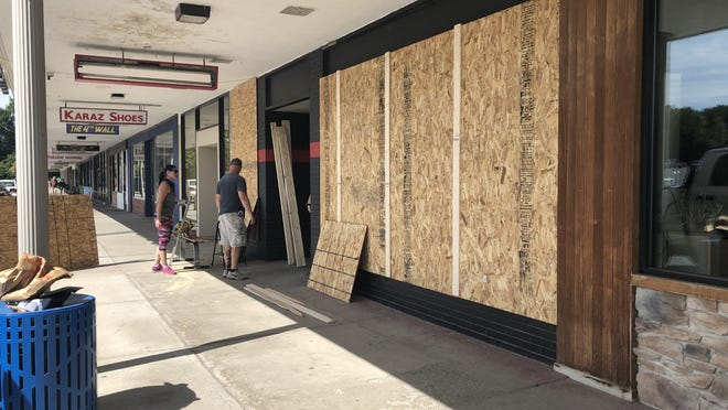 "Mohawk Valley MMA at New Hartford Shopping Center is boarded up Saturday because of what owner Duff Holmes described as ""a credible threat"" stemming from a protest in Utica."
