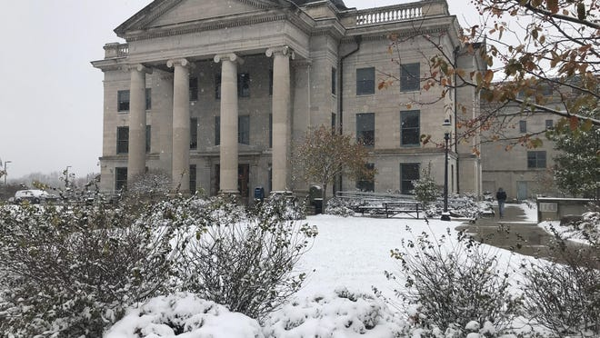 The Boone County Courthouse is shown Monday as snow blankets the ground. Offices were closed for observance of Veterans' Day as about 1.5-2 inches of snow blanketed the area.