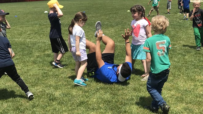 Kids and a counselor enjoy some summertime fun at the Wells Parks and Recreation Department's camp in 2019. Given the pandemic this summer, camp is going to look a little bit different.