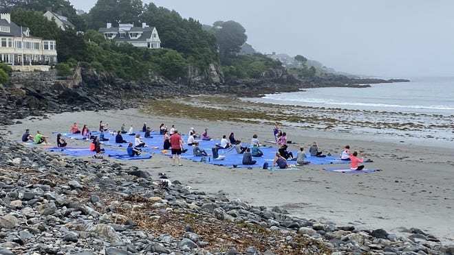Early morning yoga on York's Harbor Beach made its return on Sunday, July 5. It traditionally begins sessions on Memorial Day weekend but was delayed in starting up by the coronavirus pandemic shutdown.
