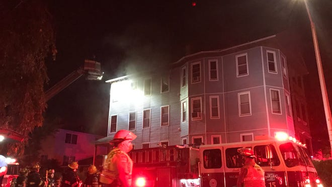 WORCESTER -- Firefighters at the scene of a three-decker fire Thursday night that displaced six people at 6 Payson St.