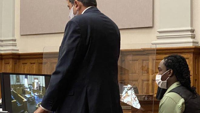 Attorney Anthony Koukoutas (left) addresses the court Thursday during the trial of his client, Josiah J. Eutsey, 20, of Canton. A Stark County Common Pleas Court jury found Eutsey guilty of murder and other charges in the 2019 shooting death of Dewayne Jackson Jr.
