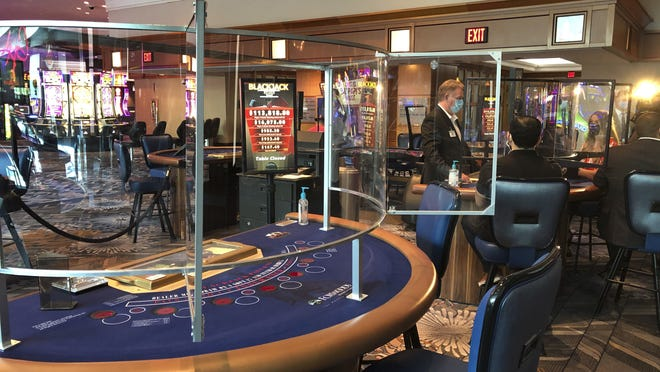 Blackjack tables are now equipped with clear, plastic barriers to protect dealers and gamblers at Foxwoods Resort Casino in Mashantucket, Conn. The Mashantucket Pequot and Mohegan Tribes have reopened their resorts on tribal lands despite opposition from Connecticut Gov. Ned Lamont.