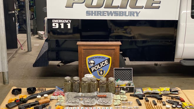 Shrewsbury police display the guns, drugs and other items recovered during an arrest Tuesday.