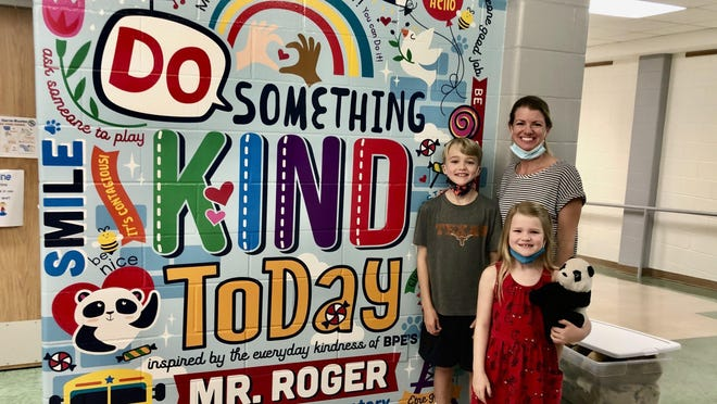 Jackson, Haley and Angela Mullen pose by the mural unveiled this month at Bridge Point Elementary to honor Roger Sanchez, a bus driver and school favorite. Sanchez died in July 2019 after a battle with cancer. Haley holds the stuffed panda that sat at the front of the bus.