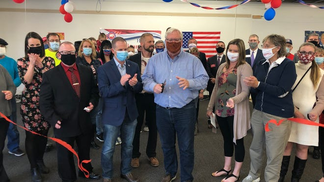 State Sen. Tom O'Mara cuts the ribbon to open the 2020 Republican campaign headquarters in Hornell on Tuesday. Mayor John Buckley, Assemblywoman Marjorie Byrnes, Hornell GOP Chairman Paul Van Caeseele and a large contingent of elected officials and Republican rank and file cheer.