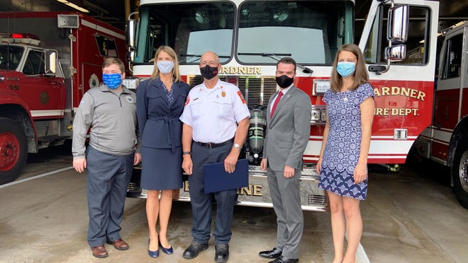 Gardner Fire Chief Richard Ares was honored on Monday, Sept. 28, just two days before his scheduled retirement. Pictured at the Gardner Fire Department, from left, are state Rep. Jon Zlotnik, U.S. Rep. Lori Trahan, Ares, Mayor Michael Nicholson and City Council President Elizabeth Kazinskas.