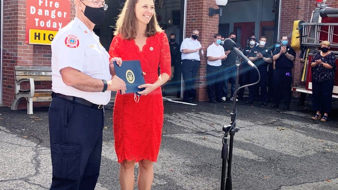 Gardner City Council President Elizabeth Kazinskas congratulates Fire Chief Richard Ares on his retirement on Wednesday, Sept. 30.