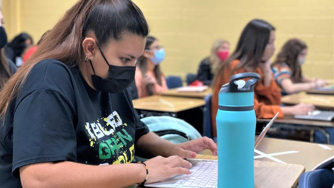 Aayliah Gallegos-Herrera, a member of the Pueblo County Class of 2021, fills out a form at the start of Monday's in-person classes.