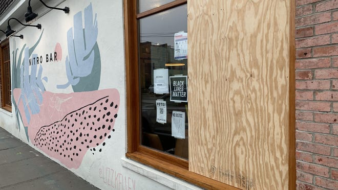 A window at The Nitro Bar in Newport was boarded up Tuesday after the coffee shop in a social media post says it was targeted and a window was smashed.