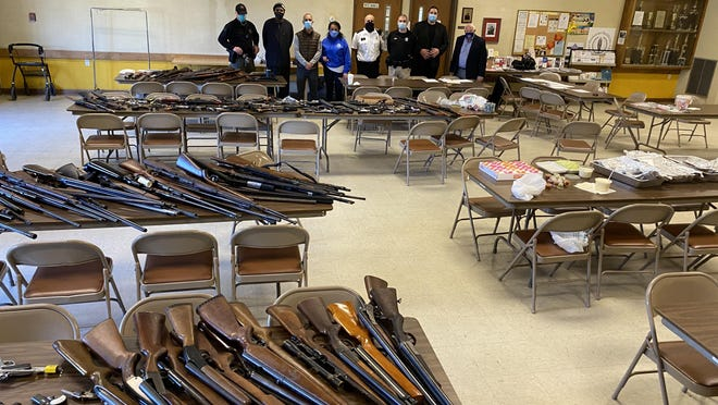 Some of the firearms turned in during Saturday's gun buyback program are displayed at the DaVinci Center in Providence.