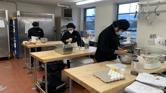 Working in the bakery program at Diman Regional Vocational Technical school's kitchen on Friday are from left, junior Zabdiel Montanez, senior Nina Faucci and Maximilian Acevedo.