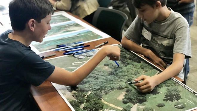 In this April 3, 2018, file photo, Bastrop Middle School students Wyatt Monk (left) and Tiernan O'Rourke discuss features they'd like to see included in a skate park in Bastrop.