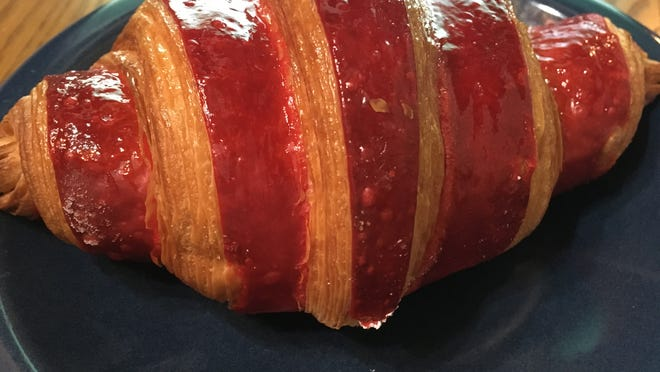 Despite the pandemic, PB Boulangerie Bistro continues to sell 1,000 croissants a day, says executive pastry chef Michel Bentz, who trained in France. This is a strawberry croissant filled with strawberry jam.