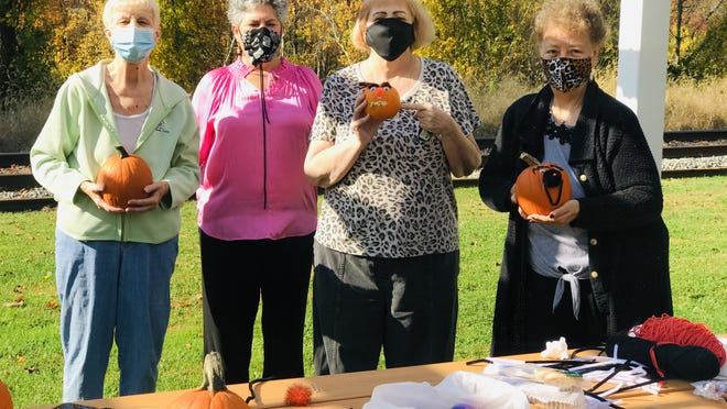 The Millbury Senior Center's Traveling Memory Café met recently to decorate pumpkins in the garden.The Memory Café is a welcoming place for people in early stages of Alzheimer's disease or other forms of dementia and their care partners, and also community members who would like to join the socialization event. Pictured from left are Pam Kostrzaba, Julie Fitzgerald, Theresa Dudzinski and Julie Pierce.