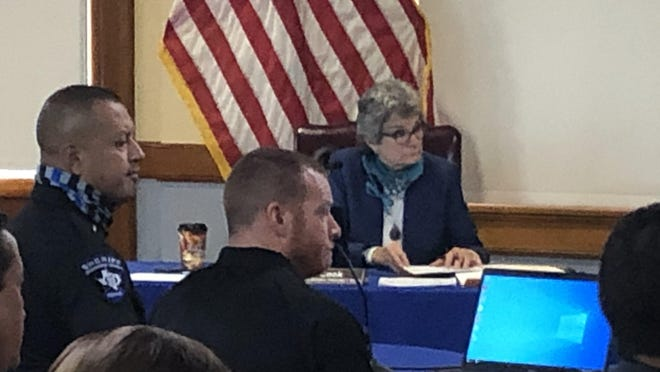 Williamson County sheriff's Deputies Mark Luera, left, and Jason Johnston, center, appear at a Commissioners Court meeting Tuesday to ask for the approval of a grant to receive excess federal defense equipment. Commissioner Terry Cook is in the background.