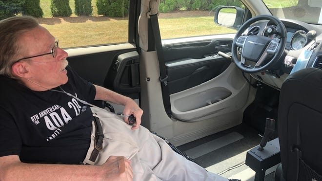 Paul Spooner, the director of the MetroWest Center for Independent Living, has a van that has been adapted to allow him to drive himself.