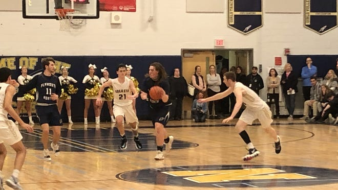 Cam Shaughnessy looks for a path to the basket last winter during Plymouth North's playoff game at Needham.