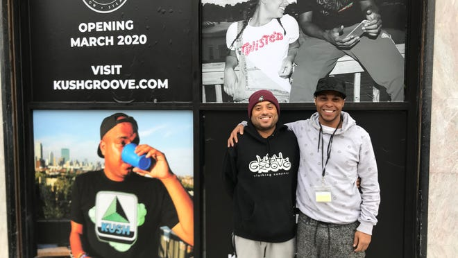 Michael Pires (left) and Marcus Johnson-Smith stand in front of their Kush Groove smoke shop that opened in Cambridge in March 2020. The two are seeking a license to open a legalized retail marijuana shop in Brockton, but said the process has been difficult.