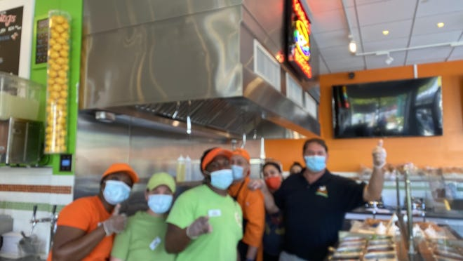 Dante Muzzioli (far right) with his staff in front of the new grill at Moozy's Ice Cream, 2 Trapelo Road, Belmont.