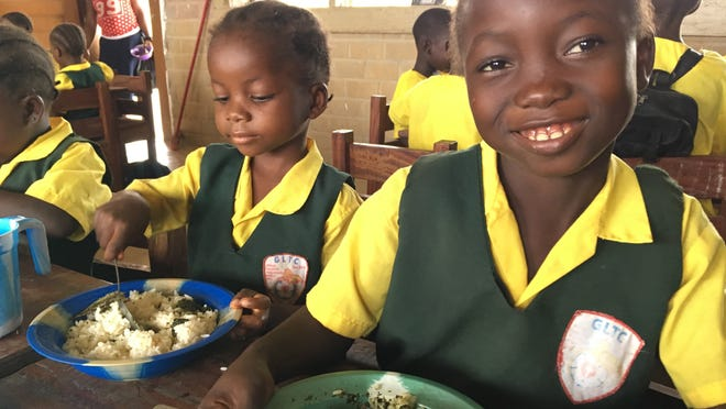 Students at the Gbarnga Lutheran Training Center enjoy a meal.