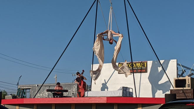 """Payomet Cirque by the Sea's circus artists Teddy Ment, Eleanor Getz and Trevor Pearson performing """"Sandman,"""" accompanied by live music by Roberto Acosta on piano."""
