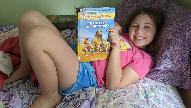 Lucy Ross of Burlington is taking part in the library's summer reading program.
