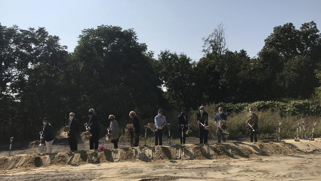 Members of the Waltham City Council participate in a groundbreaking ceremony for the new Waltham High School at 554 Lexington St. on Friday, Sept. 25, 2020.